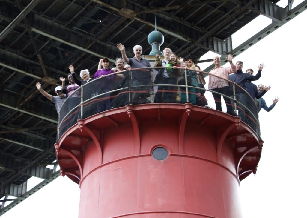 Untapped New York Insiders atop the little red lighthouse
