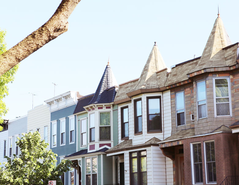 Houses in Windsor Terrace covered in varying materials.