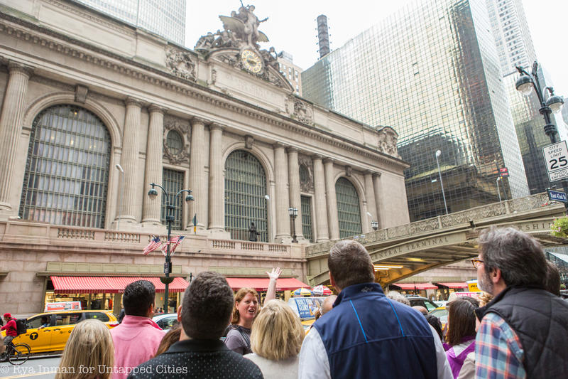 A group of tour guests admire the exterior of Grand Central Terminal