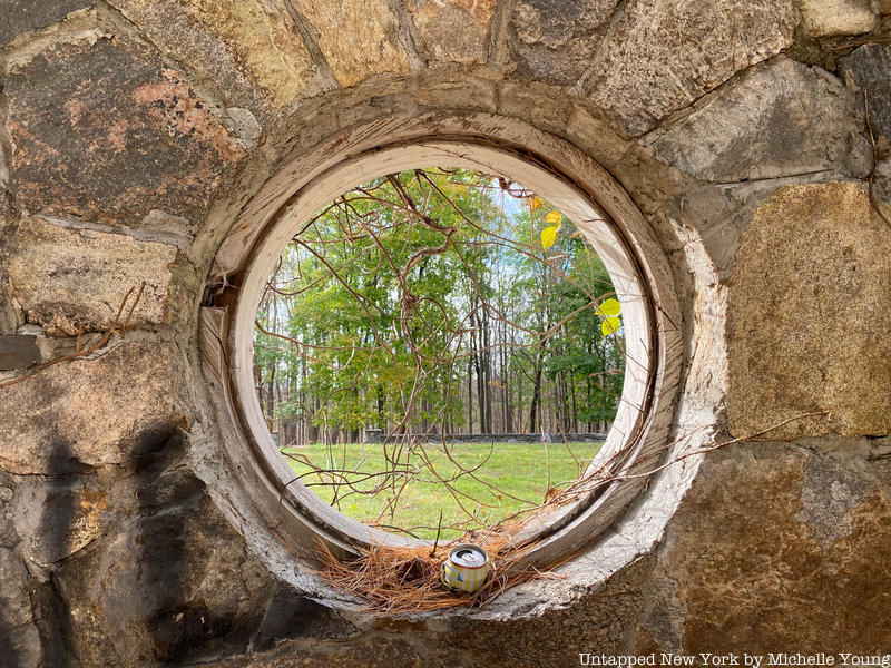 Circular window in abandoned stone ruin