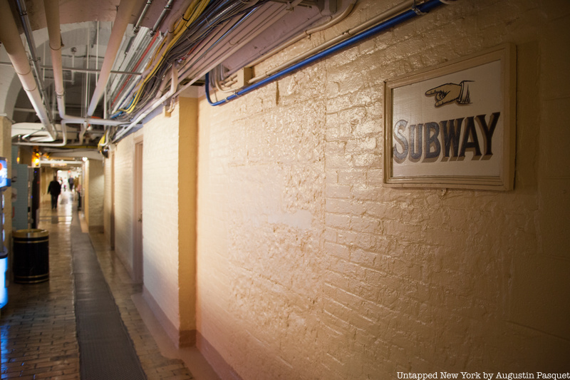 Tunnel with sign for subway under Capitol Hill