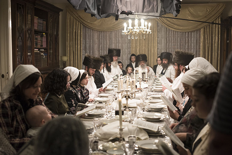 Dining table scene in Unorthodox with rabbis